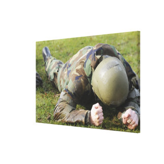 Airman crawls through a wet field stretched canvas prints