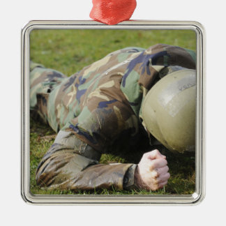 Airman crawls through a wet field christmas ornament