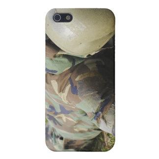 Airman crawls through a wet field iPhone 5 case