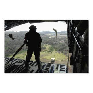 Airman watches a practice bundle fall art photo