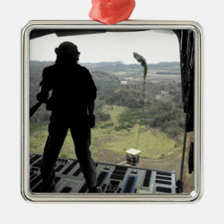 Airman watches a practice bundle fall Silver-Colored square decoration