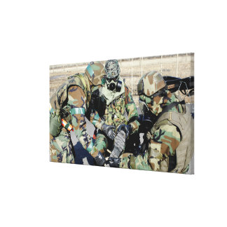 Airmen assist a Republic of Korea Army soldier Canvas Print