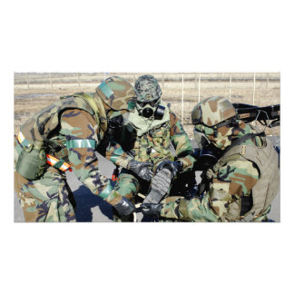 Airmen assist a Republic of Korea Army soldier Photo Print