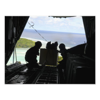 Airmen push out a pallet of donated goods 2 photographic print