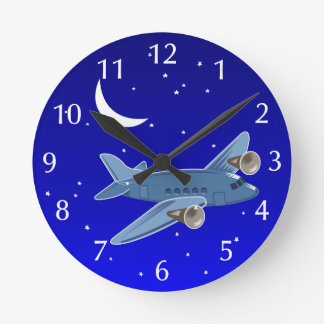 Airplane flying at night with moon & stars. Pilot Clocks