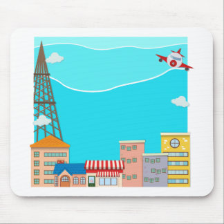 Airplane flying over the city mouse pad
