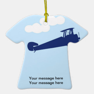 Airplane on plain pastel blue background. ornament