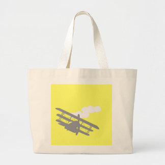 Airplane on plain yellow background canvas bag