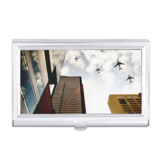 Airplanes flying over buildings business card holder