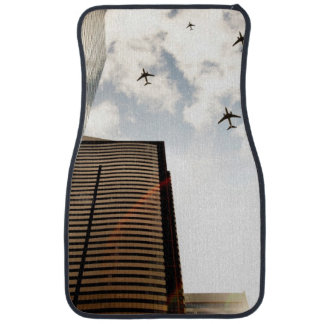 Airplanes flying over buildings car mat