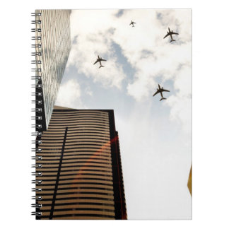 Airplanes flying over buildings notebook