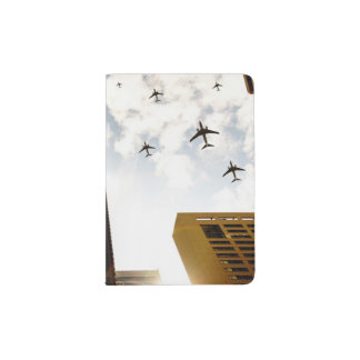 Airplanes flying over buildings passport holder