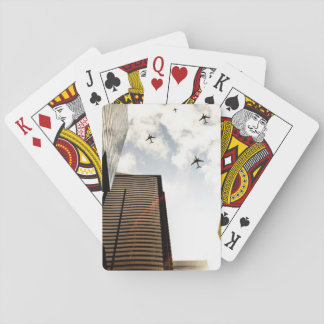 Airplanes flying over buildings playing cards