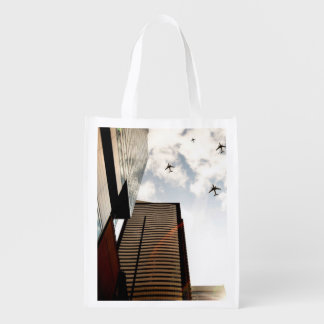 Airplanes flying over buildings reusable grocery bag
