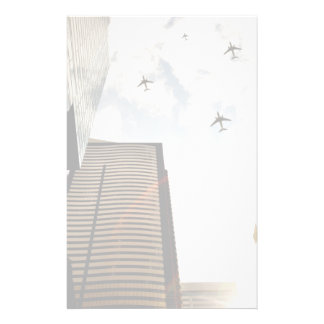 Airplanes flying over buildings stationery paper