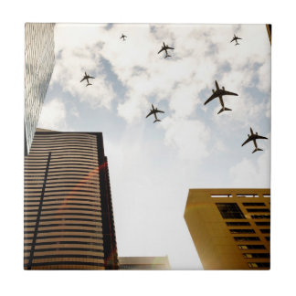Airplanes flying over buildings tile