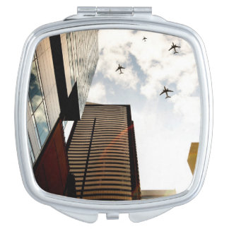 Airplanes flying over buildings vanity mirror