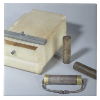 Alabaster box and bronze and silver seal cylinders large square tile