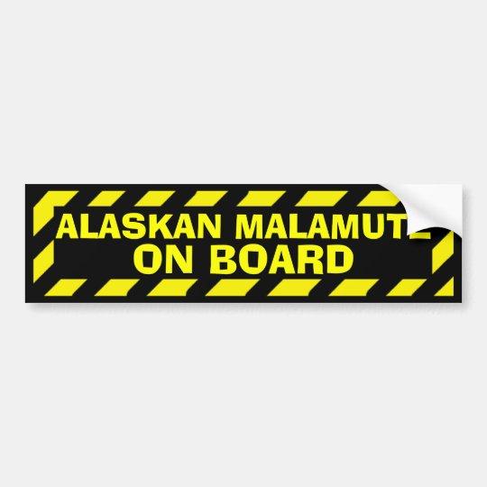 Alaskan Malamute on board yellow caution sticker