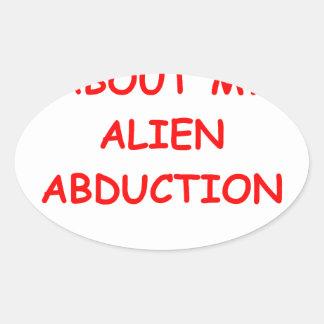 alien abduction oval sticker