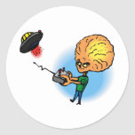 Alien boy with toy flying saucer classic round sticker