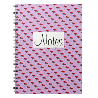 All-over poppy flower decoration on pink notebook