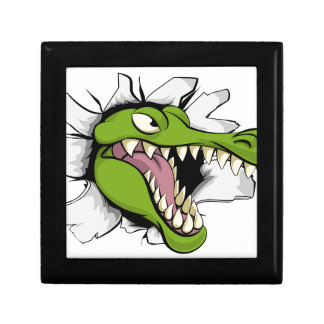 Alligator or crocodile breaking through background gift box