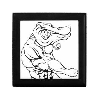 Alligator or crocodile mascot fighting small square gift box