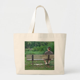 Alone on a Bench (Color) Canvas Bags