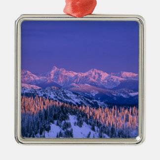 Alpenglow strikes the peaks of Glacier Christmas Ornament