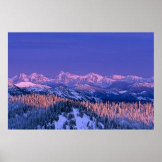 Alpenglow strikes the peaks of Glacier Poster
