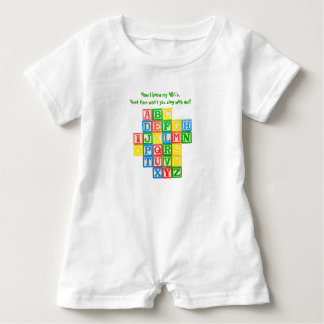 Alphabet blocks on a toddler's romper baby bodysuit