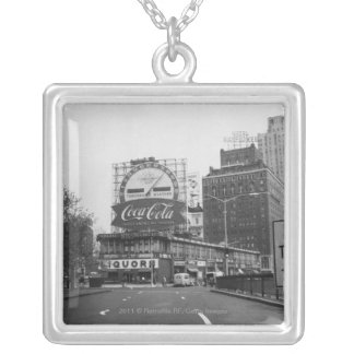 American city with commercial billboards silver plated necklace