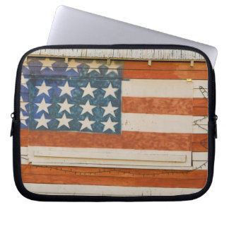 American flag painted onto fireworks stand near laptop sleeve