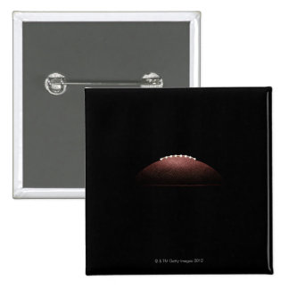 American football ball on black background 15 cm square badge