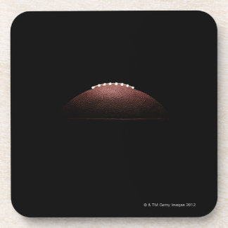 American football ball on black background coaster