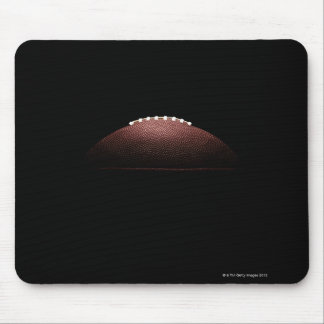 American football ball on black background mouse mat