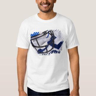 American football helmet and shirt still life