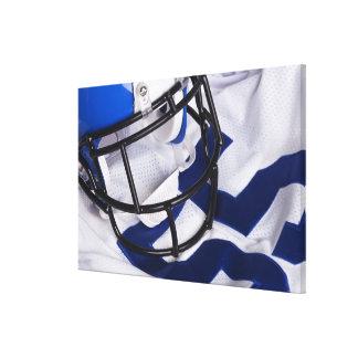 American football helmet and shirt still life canvas print