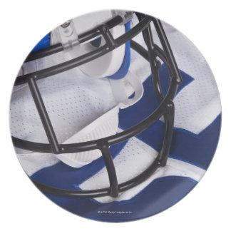 American football helmet and shirt still life plate