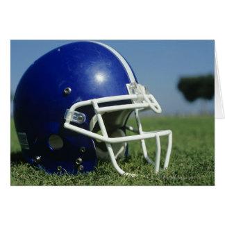 American football helmet in grass,close-up card