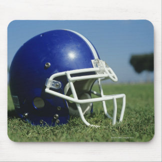American football helmet in grass,close-up mouse mat
