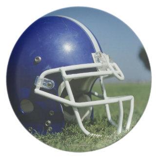 American football helmet in grass,close-up plate