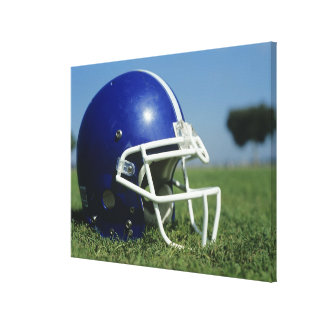 American football helmet in grass,close-up stretched canvas prints