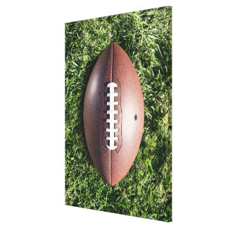 American football on grass canvas print