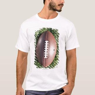 American football on grass T-Shirt