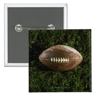 American football on grass, view from above button