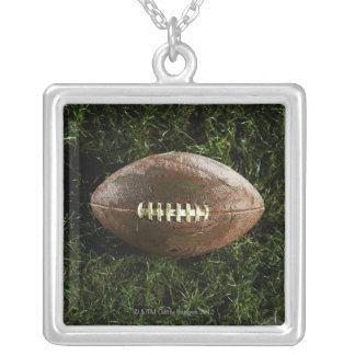 American football on grass, view from above silver plated necklace