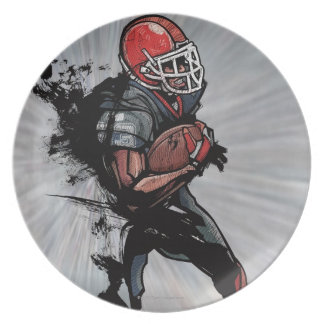 American football player holding football plate