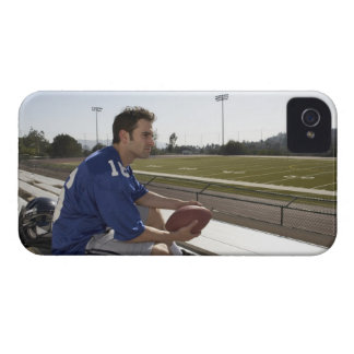 American football player sitting on bleachers iPhone 4 cover